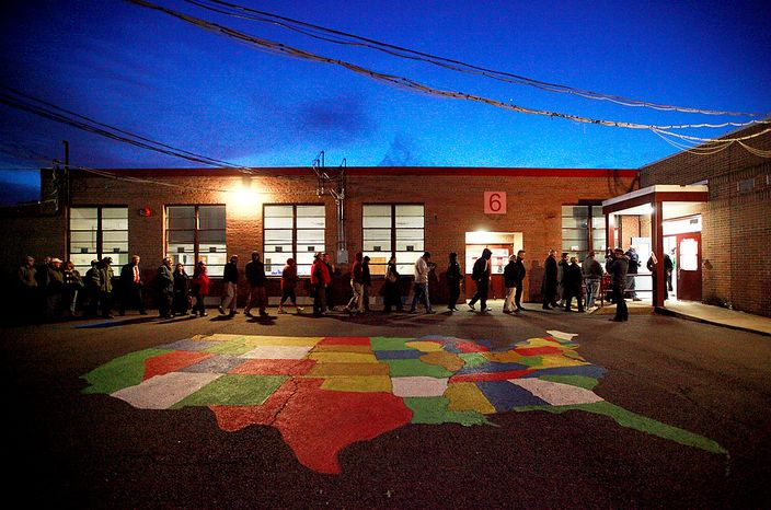Just after 6am, voters make their way into the polling station at Washington Mill Elementary School in Fairfax, Va., on November 6, 2012. (Eva Russo/ Special to The Washington Times)