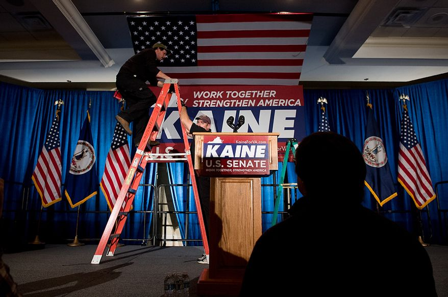 Workers get the stage ready at the Tim Kaine (D) for U.S. Senate election night party at the Richmond Marriott, Richmond, Va., Tuesday, November 6, 2012. (Andrew Harnik/The Washington Times)