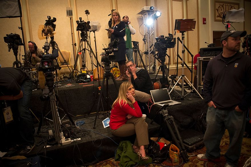 News crews prepare for a long night at Republican U.S. Senate candidate and former Virginia Governor George Allen's election night party event at the Omni Richmond Hotel in Richmond, Va., Tuesday, Nov. 6, 2012. (Rod Lamkey Jr./The Washington Times)