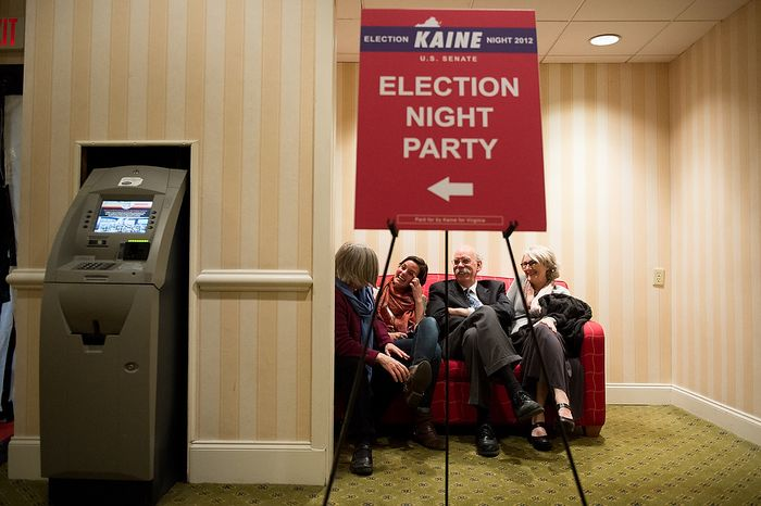 Left to right: Marty Grabett, her daughter, Mauren Campbell, 22, her husband, Mark Campbell, and their friend Patty Nicholas, all of Richmond Va., find a couch in a quiet corner just outside the Tim Kaine (D) for U.S. Senate election night party as they wait for election results to come in at the Richmond Marriott, Richmond, Va., Tuesday, November 6, 2012. (Andrew Harnik/The Washington Times)