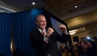 Tim Kaine, Democrat and former Virginia governor, arrives Nov. 6, 2012, to a cheering audience at his election night party at the Richmond Marriott in Richmond, Va., after defeating George Allen in the race for the U.S. Senate seat of the retiring Jim Webb. (Andrew Harnik/The Washington Times)