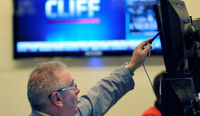James Dresch of MND Partners Inc. works on the floor of the New York Stock Exchange the day after President Obama was re-elected, Wednesday, Nov. 7, 2012, in New York. (AP Photo/Henny Ray Abrams)