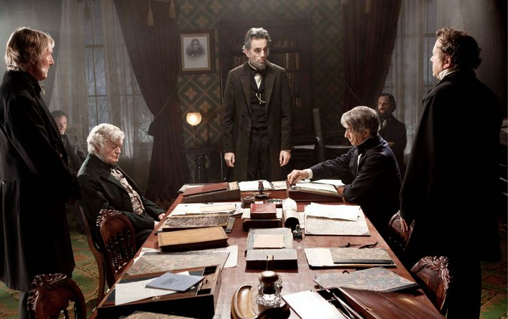 """This undated publicity photo released by DreamWorks and Twentieth Century Fox shows, Daniel Day-Lewis, center rear, as Abraham Lincoln, in a scene from the film, """"Lincoln."""" (AP Photo/DreamWorks and Twentieth Century Fox, David James)"""