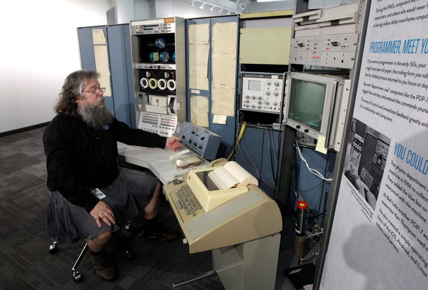 In this photo taken Oct. 30, 2012, Ian King, senior vintage systems engineer at the Living Computer Museum in Seattle, sits at the controls of a DEC PDP-7 computer from the mid 1960s, one of the oldest running computers at Paul Allen's newly opened Living Computer Museum, which features working models of old computers. (AP Photo/Ted S. Warren)