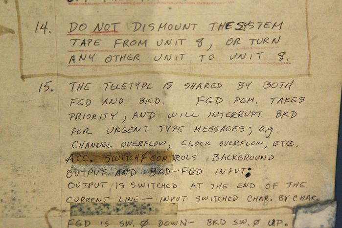 In this photo taken Oct. 30, 2012, original handwritten instructions for running a DEC PDP-7 computer from the mid 1960s is shown at the Living Computer Museum in Seattle. The newly opened museum features working models of old computers from the collections of Microsoft co-founder Paul Allen and others. (AP Photo/Ted S. Warren)