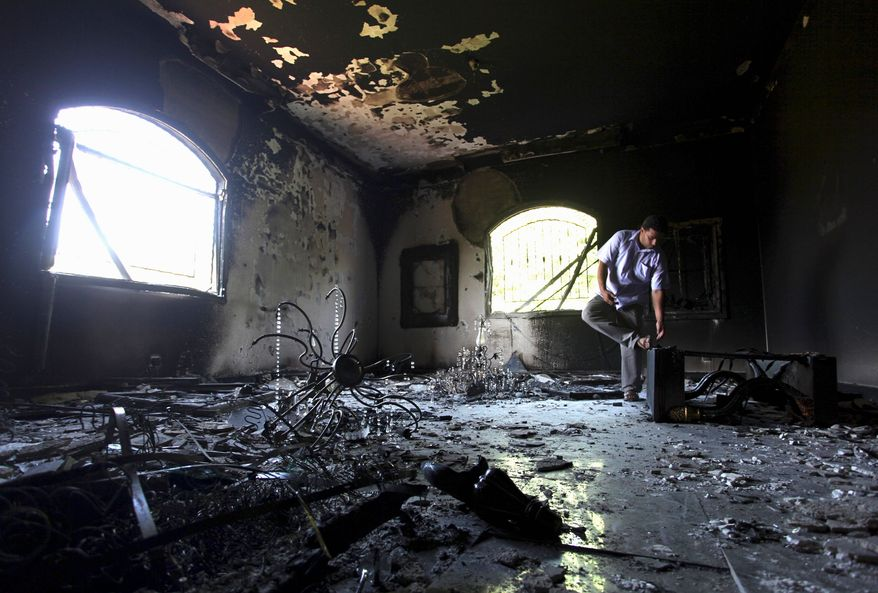 ** FILE ** A Libyan man checks out the interior of the U.S. Consulate in Benghazi, Libya, after the attack.  (Associated Press)