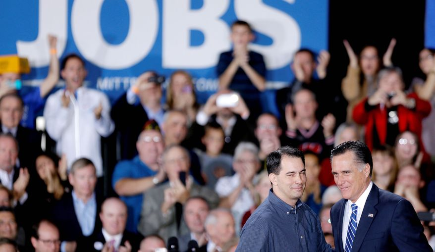 Wisconsin Gov. Scott Walker introduces Gov. Mitt Romney at a campaign event just days before the election while Wisconsin residents grew increasingly weary of robocalls, attacks ads, emails begging for donations and glossy political mail after two years of a near-continuous stream of elections, recalls and recounts in the state. (Associated Press)