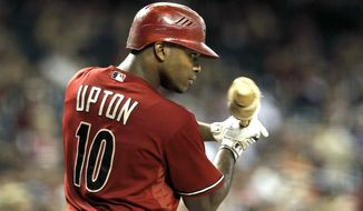 Arizona Diamondbacks' Justin Upton waits to bat against the Colorado Rockies during a baseball game Wednesday, Oct. 3, 2012, in Phoenix.  The Rockies defeated the Diamondbacks 2-1. (AP Photo/Ross D. Franklin)