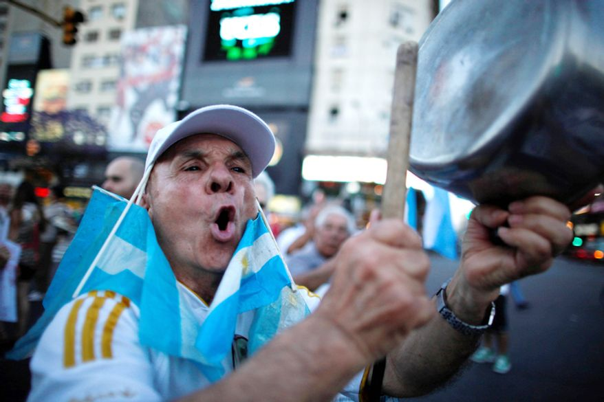 ** FILE ** A protester bangs a pot during a march against Argentina's President Cristina Fernandez in Buenos Aires, Argentina. (AP Photo/Natacha Pisarenko)