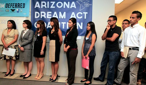 **FILE** Young immigrants, along with members of local immigrant organizations, line up Aug. 15, 2012, in Phoenix for guidance for a new federal program called Deferred Action that would help them avoid deportation. The nationwide program will allow young immigrants to get work permits but not a path to citizenship. (Associated Press)