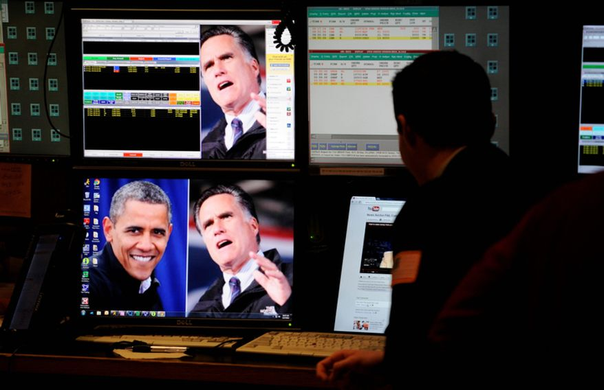 "A trader on the floor of the New York Stock Exchange looks at images of the presidential contenders on Nov. 7, 2012, the day after President Obama was re-elected. U.S. investors dumped stocks and turned their focus to a world of problems, including a ""fiscal cliff"" of tax increases and spending cuts at home and a deepening recession in Europe. (Associated Press)"