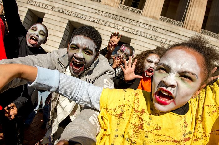 """Kechelle Settle, 8, right, and fellow Savoy Elementary School students perform a flash mob dance to Michael Jackson's """"Thriller"""" in front of the National Portrait Gallery as a way to teach music theory, movement and the impact of the song on the music industry and the """"cultural fabric of our society,"""" Washington, D.C., Thursday, November 8, 2012. (Andrew Harnik/The Washington Times)"""