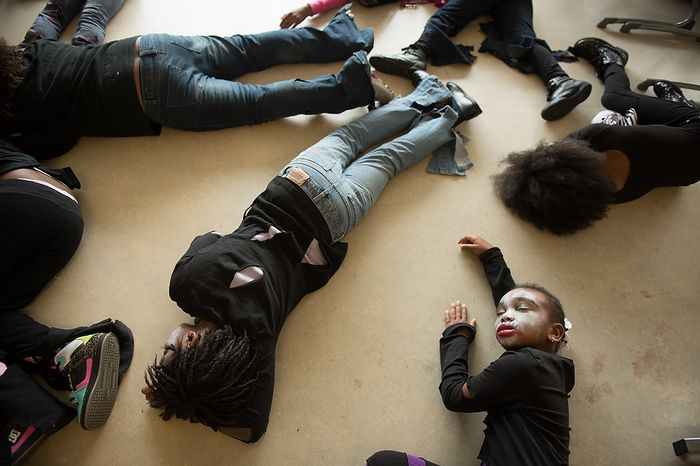 """Jionni Anderson, 8, bottom right, and other Savoy Elementary School students practice their flash mob dance routine to Michael Jackson's """"Thriller"""" in their classroom before heading to the National Portrait Gallery to perform in public as a way to teach music theory, movement and the impact of the song on the music industry and the """"cultural fabric of our society,"""" Washington, D.C., Thursday, November 8, 2012. (Andrew Harnik/The Washington Times)"""