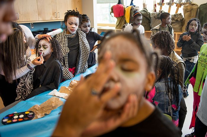 """Nakijah Pace, 9, left, and other Savoy Elementary School students get their makeup done before performing a flash mob dance to Michael Jackson's """"Thriller"""" in front of the National Portrait Gallery as a way to teach music theory, movement and the impact of the song on the music industry and the """"cultural fabric of our society,"""" Washington, D.C., Thursday, November 8, 2012. (Andrew Harnik/The Washington Times)"""