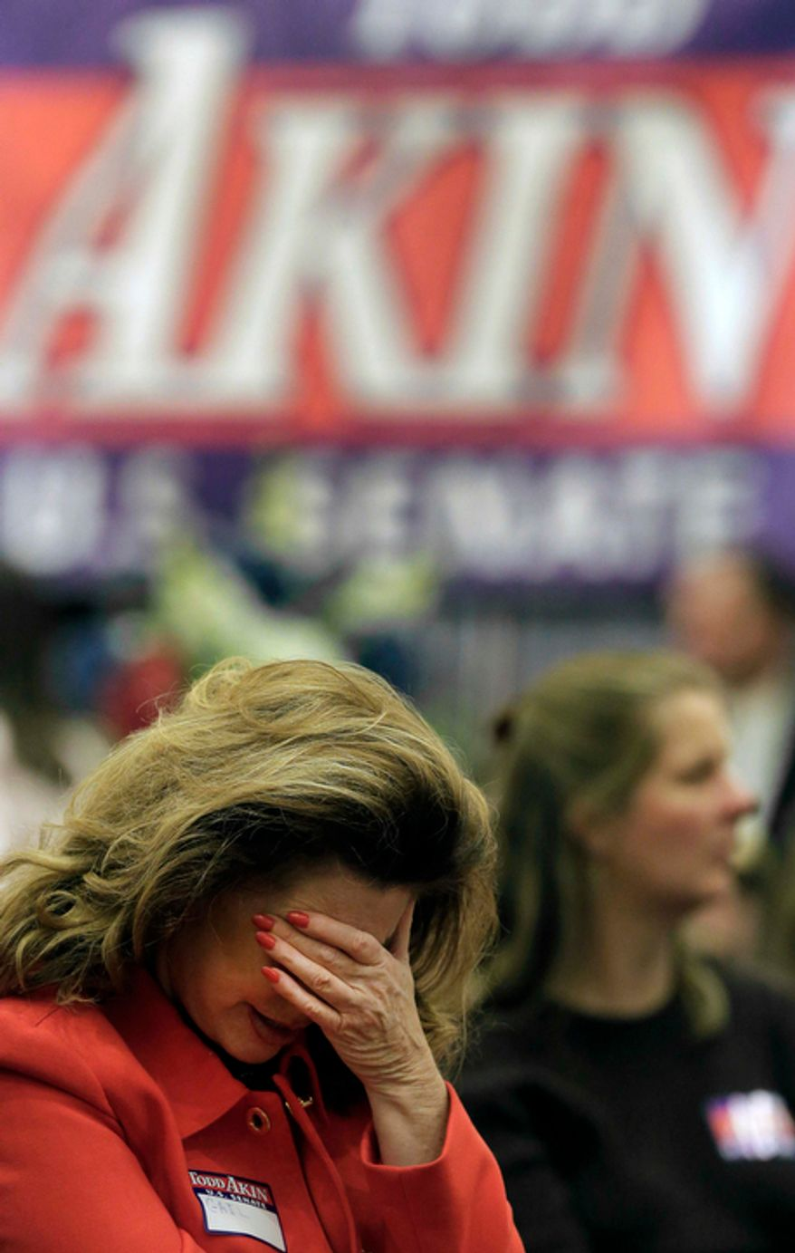 Gail Bowman of St. Louis reacts Nov. 6, 2012, after hearing that Todd Akin, Republican candidate for U.S. Senate in Missouri, lost to Democratic incumbent Claire McCaskill during Akin's watch party in Chesterfield, Mo. (Associated Press)