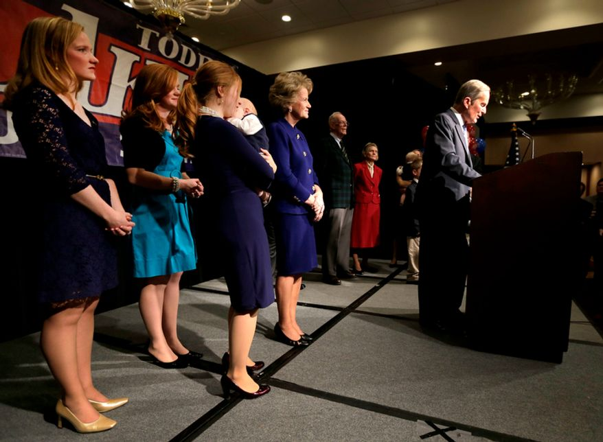 Rep. Todd Akin, Missouri Republican and U.S. Senate candidate, is backed by family members as he concedes to Democratic incumbent Claire McCaskill on Nov. 6, 2012, in Chesterfield, Mo. (Associated Press)