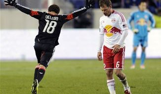 DC United midfielder Nick DeLeon (left) celebrates at the end of the MLS Eastern Conference semifinal playoff game as New York Red Bulls midfielder Teemu Tainio (6) and goalkeeper Luis Robles react on Thursday, Nov. 8, 2012, in Harrison, N.J. DeLeon scored the only goal of the game as DC United defeated the Red Bulls 1-0 to advance to the next round. (AP Photo/Bill Kostroun)