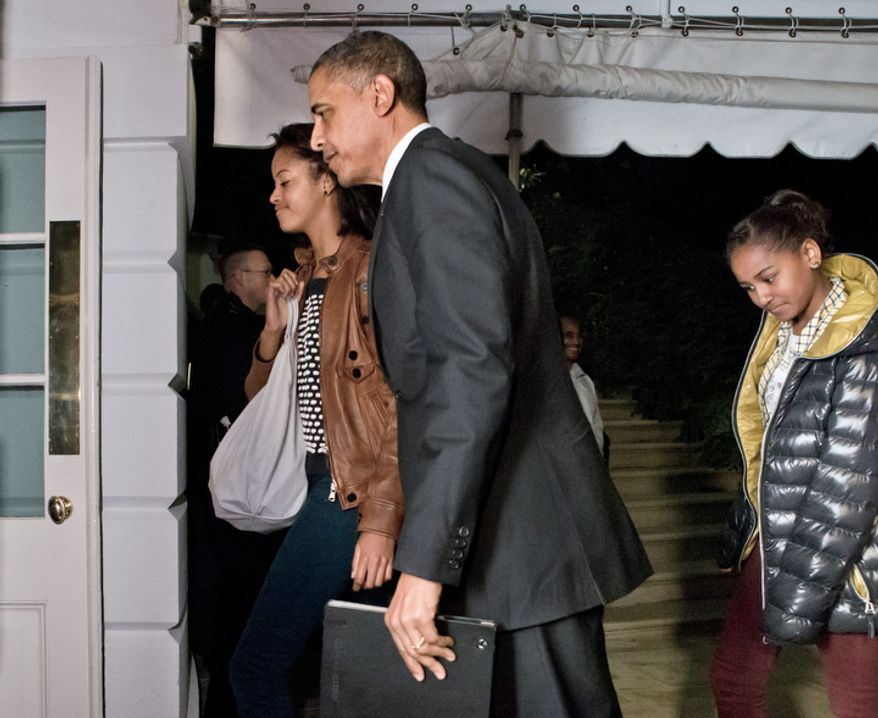 President Obama and daughters Malia (left) and Sasha return to the White House in Washington on Nov. 7, 2012, for the first time since his victory on Election Day. (Associated Press)