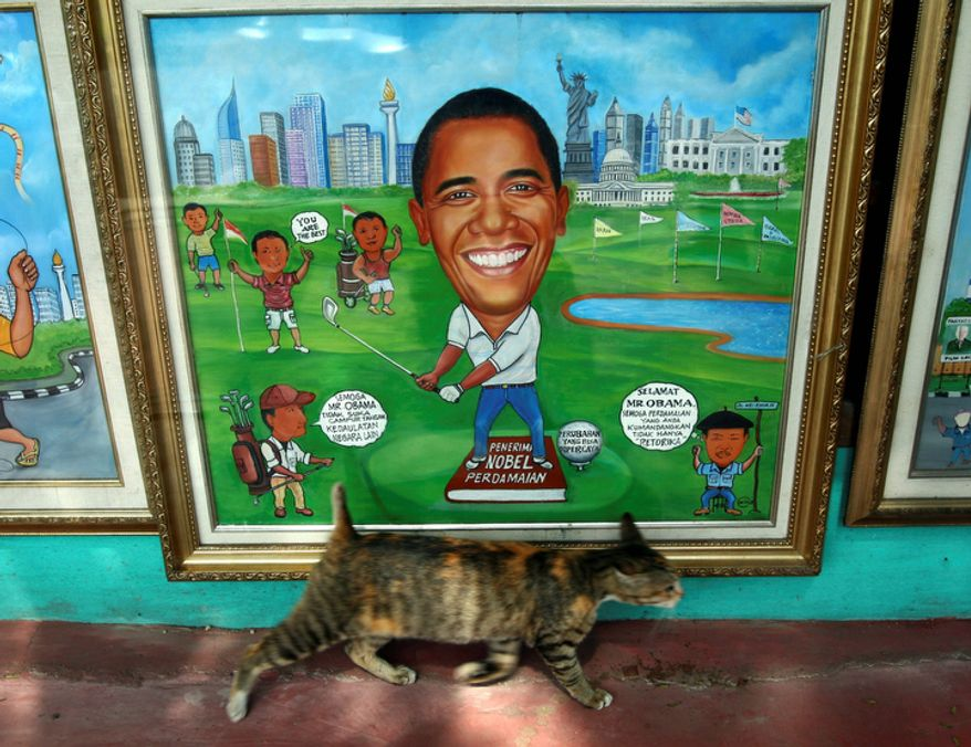 "A cat passes in front of a painting of President Obama at a roadside studio in Jakarta, Indonesia, on Nov. 8, 2012. The writing at left in the painting reads, ""Hope Mr. Obama does like to intervene in the sovereignty of other countries."" The writing at right reads, ""Congratulations Mr. Obama. Hopefully the peace you are promoting is not only rhetoric."" (Associated Press)"