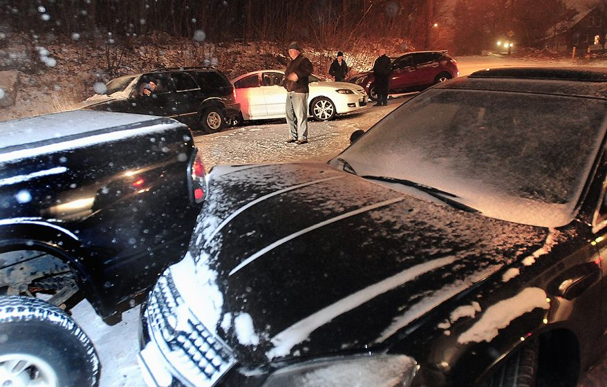 Motorists involved in an 11-car pile-up in Worcester, at the intersection of Chester and West Chester Streets wait for tow trucks and police to arrive, Wednesday, Nov. 7, 2012. Residents from Connecticut to Rhode Island saw 3 to 6 inches of snow on Wednesday. Worcester, Mass., had 8 inches of snow, and Freehold, N.J., had just over a foot overnight.  (AP Photo/Worcester Telegram & Gazette, Steve Lanava)