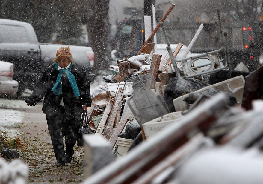 A woman, who did not want to give her name, returns from work in the snow to her house in the New Dorp section of Staten Island, N.Y., on Nov. 7, 2012. (Associated Press)