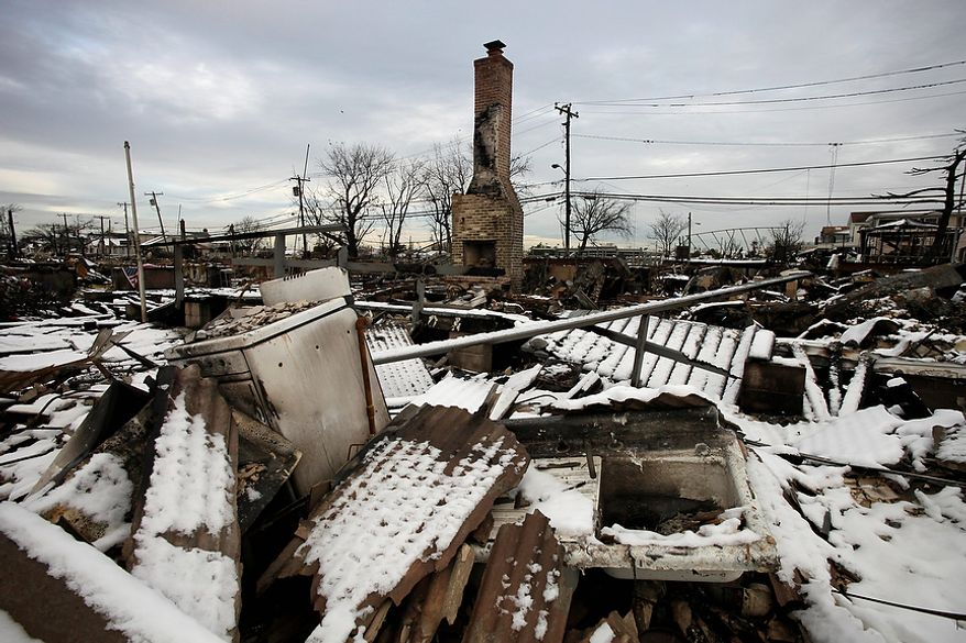 A fire-scorched landscape of Breezy Point is shown after a Nor'easter snow, Thursday, Nov. 8, 2012 in New York.  The beachfront neighborhood was devastated during Superstorm Sandy when a fire pushed by the raging winds destroyed many homes.  (AP Photo/Mark Lennihan)