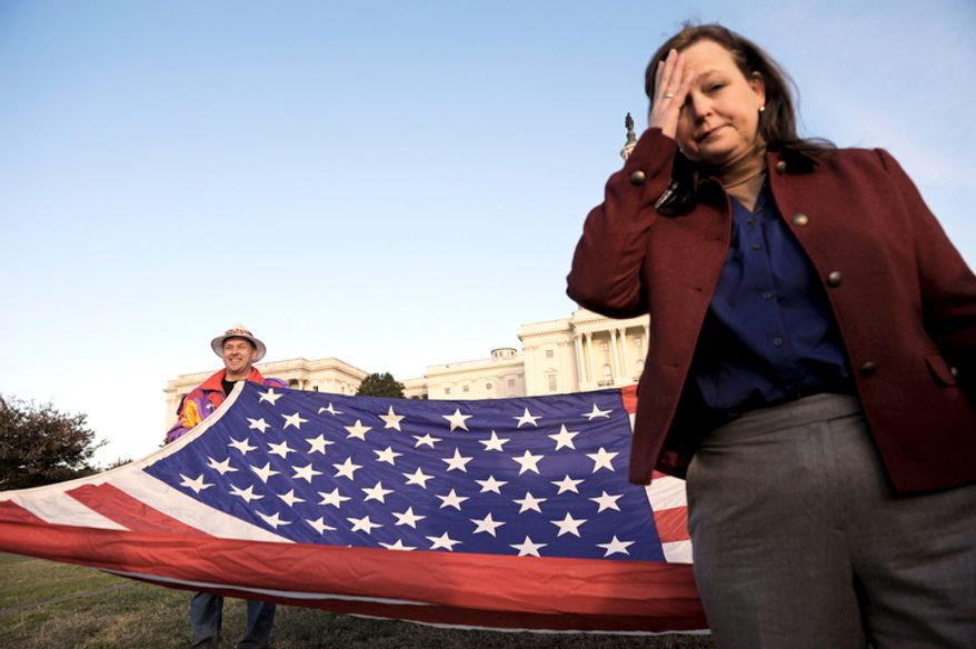 ** FILE ** Tea Party Patriots co-founder Jenny Beth Martin pauses while organizing the start of an Election Day demonstration on the lawn of the Capitol in Washington on Nov. 2, 2010. (Associated Press)