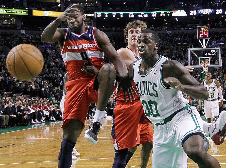 Washington Wizards forward Martell Webster (9) and forward Jan Vesely, middle, battle with Boston Celtics forward Brandon Bass (30) for a rebound during the first half of an NBA basketball game in Boston, Wednesday, Nov. 7, 2012. (AP Photo/Elise Amendola)