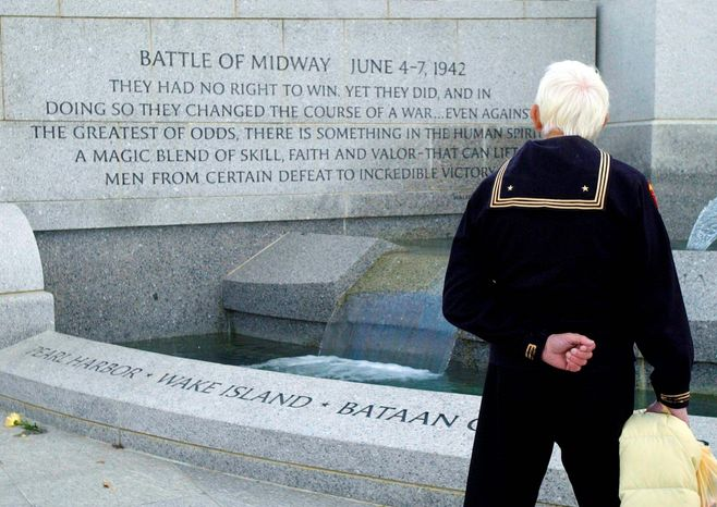 Warren Edward Nalls Sr. 80, visits the National World War II Memorial on the Mall on Veterans Day 2005. Mr. Nalls, of Alexandria, was in the Coast Guard and fought in the Atlantic and Pacific in World War II. Veterans from other wars also were at the memorial during his visit. (The Washington Times)