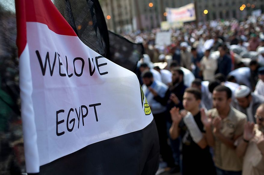 Egyptian Muslims pray during a Nov. 9, 2012, rally in Tahrir Square in Cairo. Thousands of ultraconservative Muslims rallied in the Egyptian capital, demanding the country's new constitution be based on the rulings of Islamic law, or Shariah. (Associated Press)