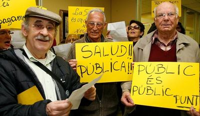 **FILE** Yayoflautas occupy the Barcelona headquarters of the Catalan private healthcare provider's association in protest against cuts in health spending on Dec. 22, 2011. (Oscar Martinez/Special to The Washington Times)