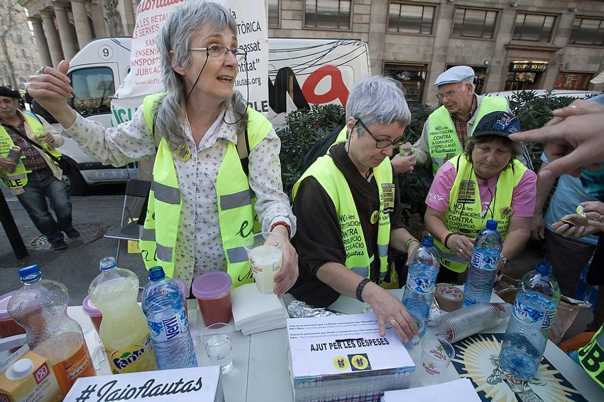 Yayoflautas give out refreshments while participating in a general strike in Barcelona on March 29, 2012. (Oscar Martinez/Special to The Washington Times)