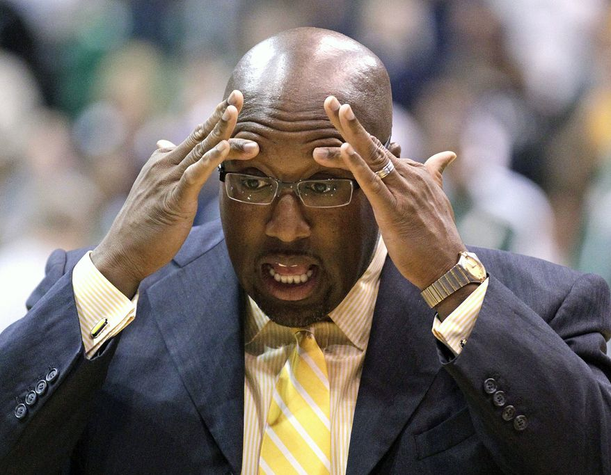 Los Angeles Lakers head coach Mike Brown holds his head Nov. 7, 2012, before the start of the first quarter of a game against the Utah Jazz in Salt Lake City. (Associated Press)