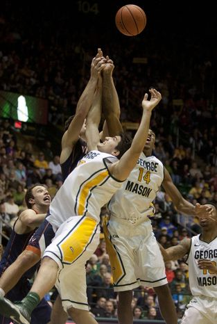 George Mason Patriots forward Anali Okoloji (14), right, and forward Marko Gujanicic (40) go up for a rebound against the Virginia Cavaliers in the second half at the Patriot Center in Fairfax, Va., Wednesday, November 9, 2012. George Mason Patr
