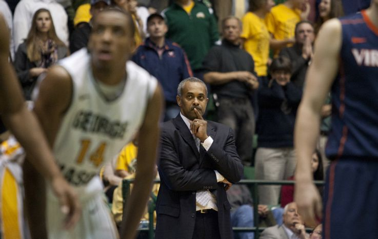 George Mason Patriots head coach Paul Hewitt watches guard Bryon Allen (0) attempt a foul shot in the final second against the Virginia Cavaliers at the Patriot Center in Fairfax, Va., Wednesday, November 9, 2012. George Mason Patriot