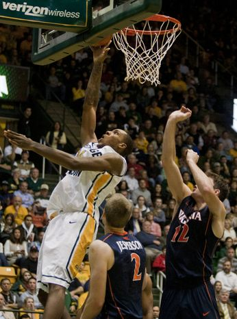 George Mason Patriots forward Paris Bennett (1) makes a lay up against the Virginia Cavaliers in the second half at the Patriot Center in Fairfax, Va., Wednesday, November 9, 2012. George Mason Patriots host the Virginia Cavaliers for the 2012-2013 men's college basketball season opener. (Craig Bisacre/The Washington Times)