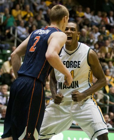 George Mason Patriots forward Anali Okoloji (14) celebrates after making a basket in the second half against the Virginia Cavaliers at the Patriot Center in Fairfax, Va., Wednesday, November 9, 2012. George Mason Patriots host the Virginia Cavaliers for the 2012-2013 men's college basketball season opener. (Craig Bisacre/The Washington Times)
