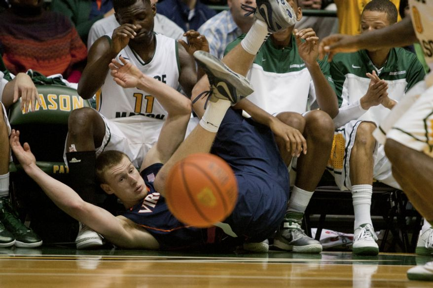 Virginia Cavaliers guard Paul Jesperson (2) falls out of bounds and turns over the ball against the George Mason Patriots at the Patriot Center in Fairfax, Va., Wednesday, November 9, 2012. George Mason Patriots host the Virginia Cavaliers for the 2012-2013 men's college basketball season opener. (Craig Bisacre/The Washington Times)
