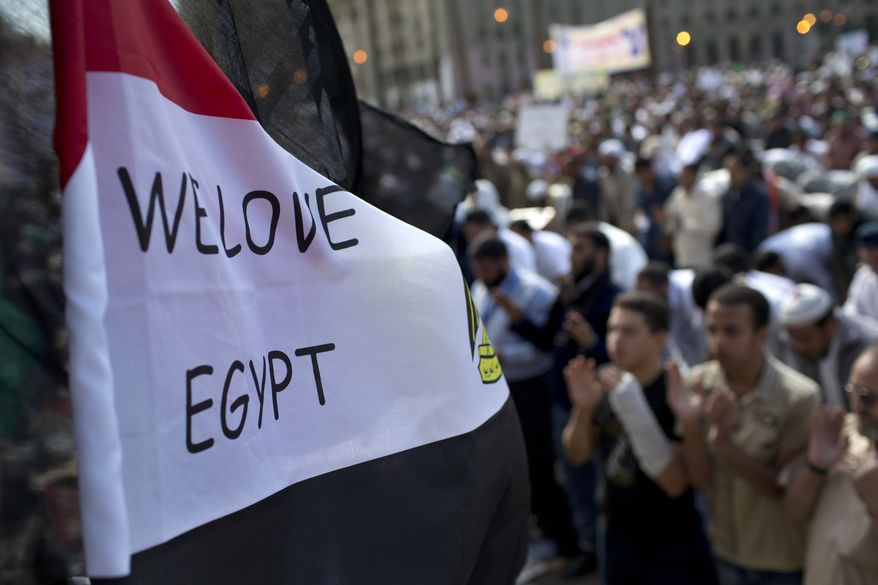Egyptian Muslims pray Nov. 9, 2012, during a rally in Tahrir Square in Cairo. Thousands of ultraconservative Muslims rallied in the Egyptian capital, demanding the country's new constitution be based on the rulings of Islamic law, or Shariah. (Associated Press)