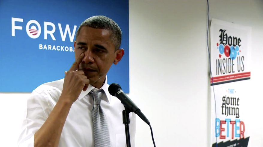 In this still image from a BarackObama.com campaign video, President Obama wipes away tears as he thanks members of his campaign staff and volunteers in Chicago on Nov. 7, 2012, a day after he won re-election. (Associated Press/BarackObama.com)
