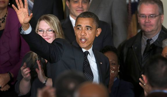 President Obama waves Nov. 9, 2012, as he leaves the East Room of the White House in Washington after he spoke about the economy and the deficit. (Associated Press)