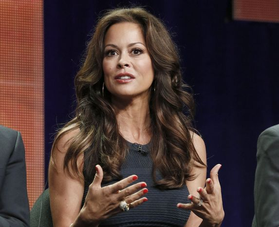 """**FILE** Brooke Burke-Charvet sits on the """"Dancing with the Stars: All Stars"""" panel at the Disney ABC TCA Day 2 in Beverly Hills, Calif., on July 27, 2012. (Todd Williamson/Invision/Associated Press)"""