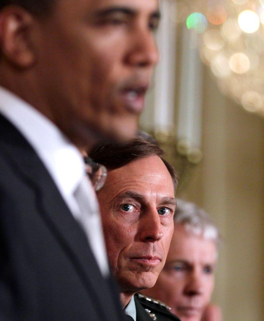 **FILE** CIA Director-nominee Gen. David Petraeus (second from left) looks on as President Obama speaks on April 27, 2011, during a news conference in the East Room of the White House in Washington. Far right is U.S. Ambassador to Afghanistan-designate Ray Crocker. (Associated Press)