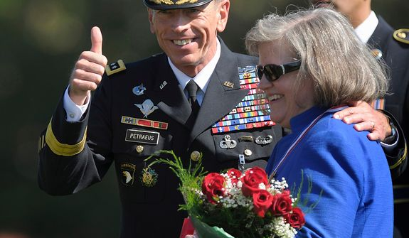 **FILE** Davis Petraeus, former Commander of International Security Assistance Force and U.S. Forces-Afghanistan general, stands with his wife, Holly, as he participates in an Armed Forces farewell tribute and retirement ceremony on Aug. 31, 2011, at Joint Base Myer-Henderson Hall in Arlington, Va. (Associated Press)