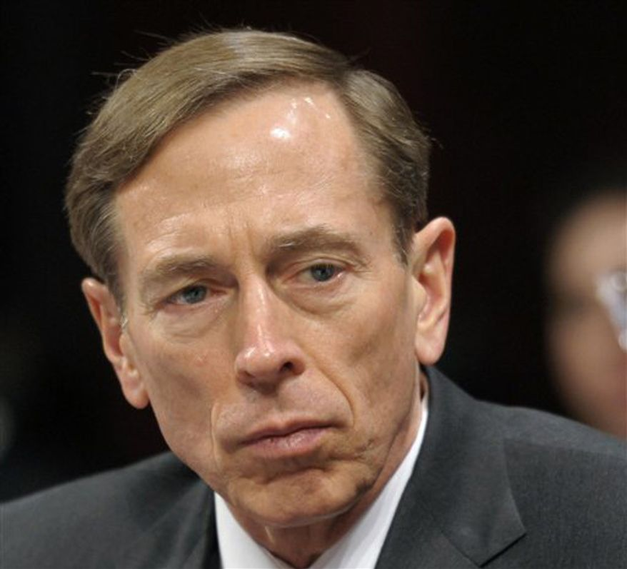 This Feb. 2, 2012 file photo shows CIA Director David Petraeus testifying on Capitol Hill in Washington. Petraeus has resigned because of an extramarital affair.  (AP Photo/Cliff Owen, File)