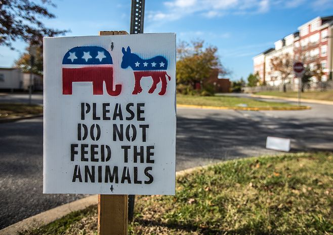 A sign outside of Mills-Parole Elementary School tells voters to not feed the animals in Annapolis, MD., Tuesday, November 6, 2012. Voters cast their ballots for many issues, including same-sex marriage and legalizing medical marijuana.(Andrew S. Geraci/The Washington Times)