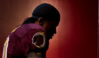 Washington Redskins quarterback Robert Griffin III (10) heads back into the tunnel after warm ups before the Washington Redskins take on the Carolina Panthers at FedEx Field, Landover, Md., Sunday, November 4, 2012. (Andrew Harnik/The Washington Times)