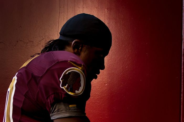 Washington Redskins quarterback Robert Griffin III (10) heads back into the tunnel after warm ups before the Washington Redskins take on the Carolina Panthers at FedEx Fiel