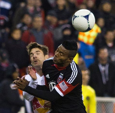 D.C. United forward Lionard Pajoy (26) collides with New York Red Bulls defender Jonathan Borrajo (3) during the second half of the Eastern Conference semifinals playoff match at RFK Stadium, Washington, D.C.,  Saturday, November 3, 2012. (Craig Bisacre/The Washington Times)