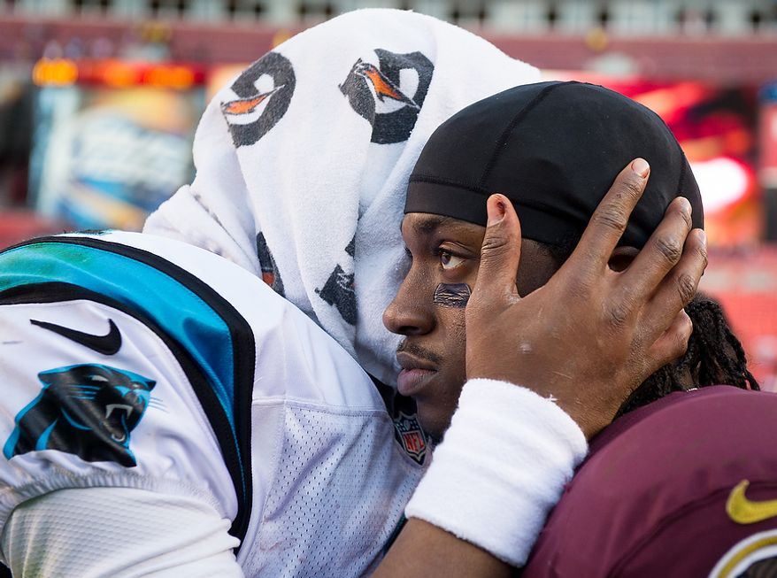 Washington Redskins quarterback Robert Griffin III (10) and Carolina Panthers quarterback Cam Newton (1) talk together at the end of the game after the Washington Redskins lose to the Carolina Panthers 21-13 at FedEx Field, Landover, Md., Sunday, November 4, 2012. (Andrew Harnik/The Washington Times)